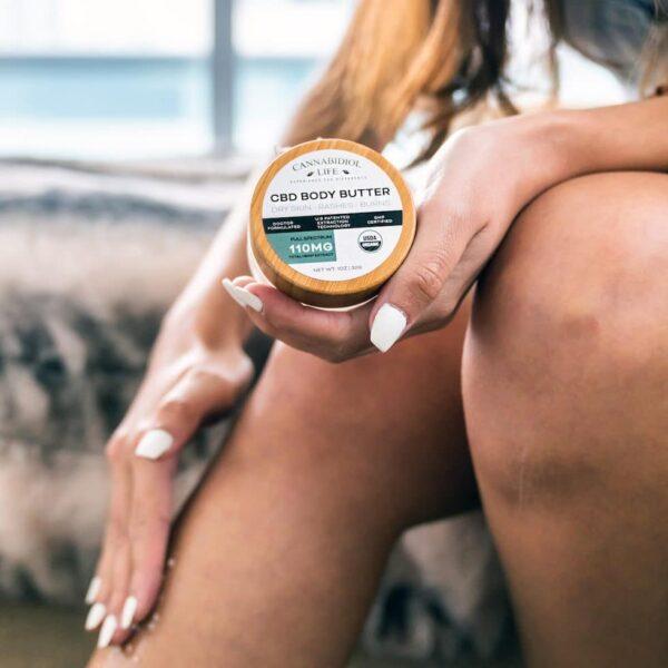 Woman Using Cbd Body Butter On Her Legs